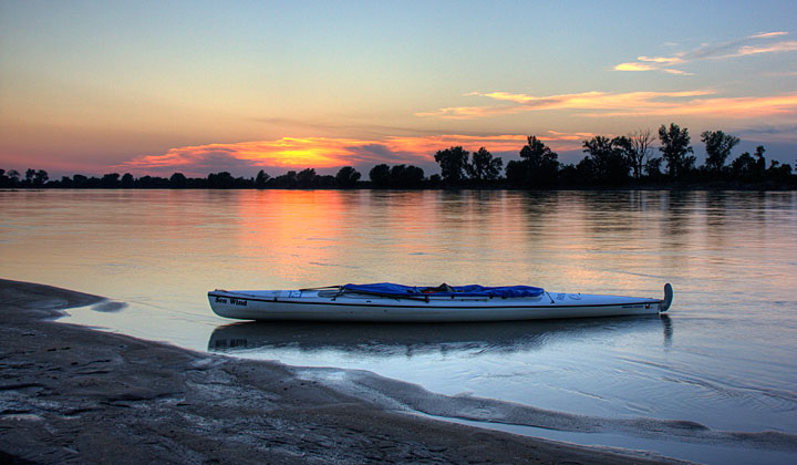 Sea Wind canoe and sunset over Missouri River